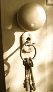 keys in door face